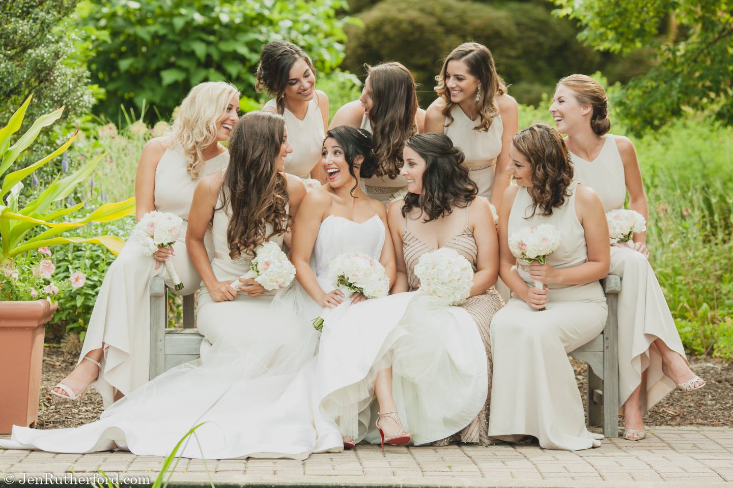 bridesmaids in white dresses with bride