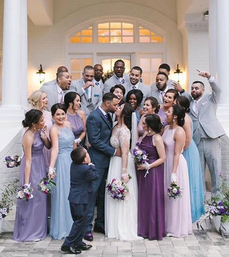 purple and blue wedding party with matching dresses, ties and pocket squares