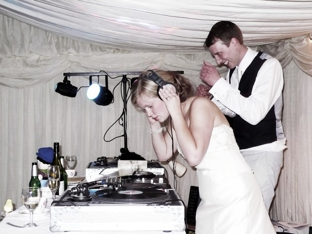 The bride and groom were DJs at their wedding