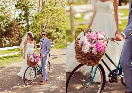 bride and groom with bicycle and basket with pink peonies