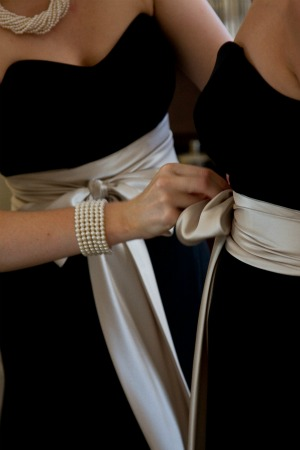 black bridesmaid dresses with oyster satin sashes