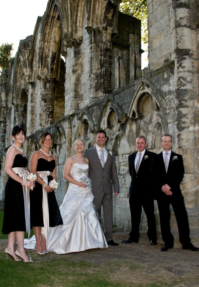 bridal party photographed by romantic ruin