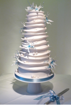 white tiered wedding cake with blue flowers