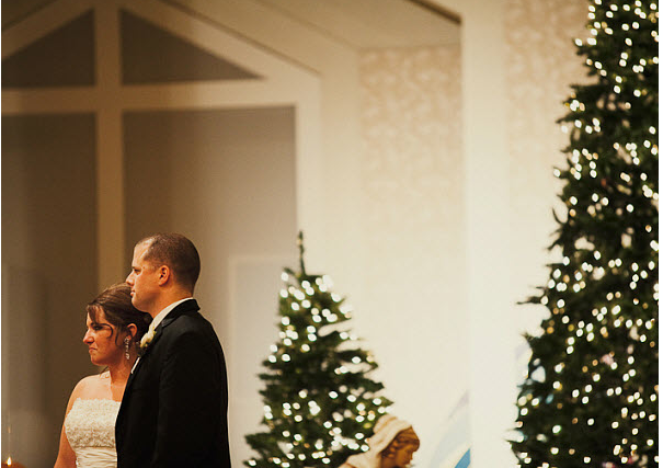 Couple with Christmas trees at January wedding