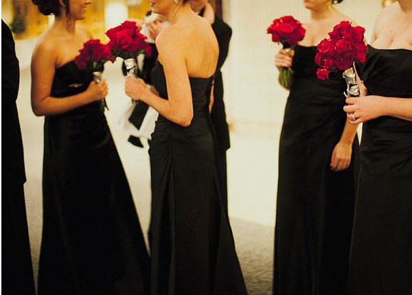 Bridesmaids in black dresses at January wedding
