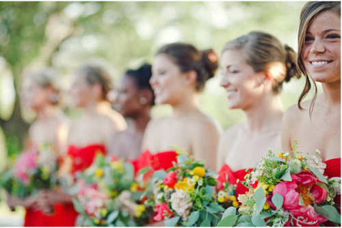 bridesmaids in red with colourful bouquets