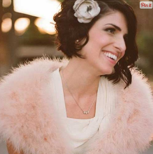 bride with short hair and flower accessory