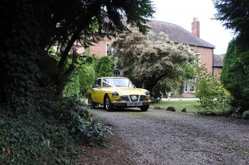 yellow MG leaving bride's house
